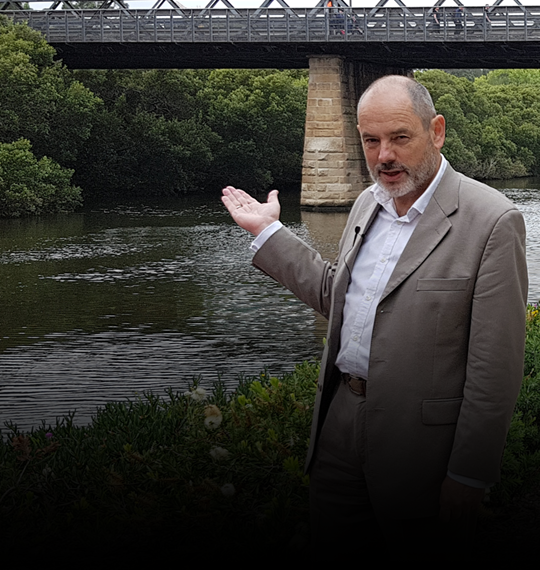 Rod Simpson standing in front of the Parramatta River