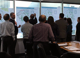 A group of planners examining maps of Greater Sydney