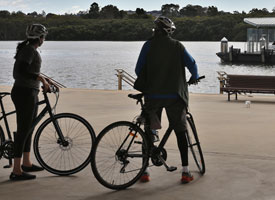 Two cyclists at Wentworth Point on the Parramatta River
