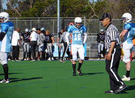 Ed Blakely refereeing a local suburban match game of American football.