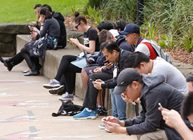 A group of people using mobile devices
