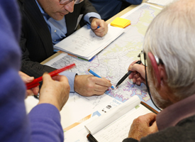 People making notations on a map
