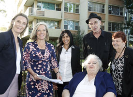 Sarah Hill and Lucy Turnbull with local residents