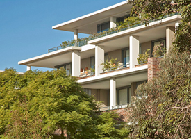 Medium density apartment building surrounded by trees