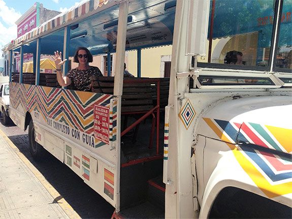 Dr Deborah Dearing waving from a bus window