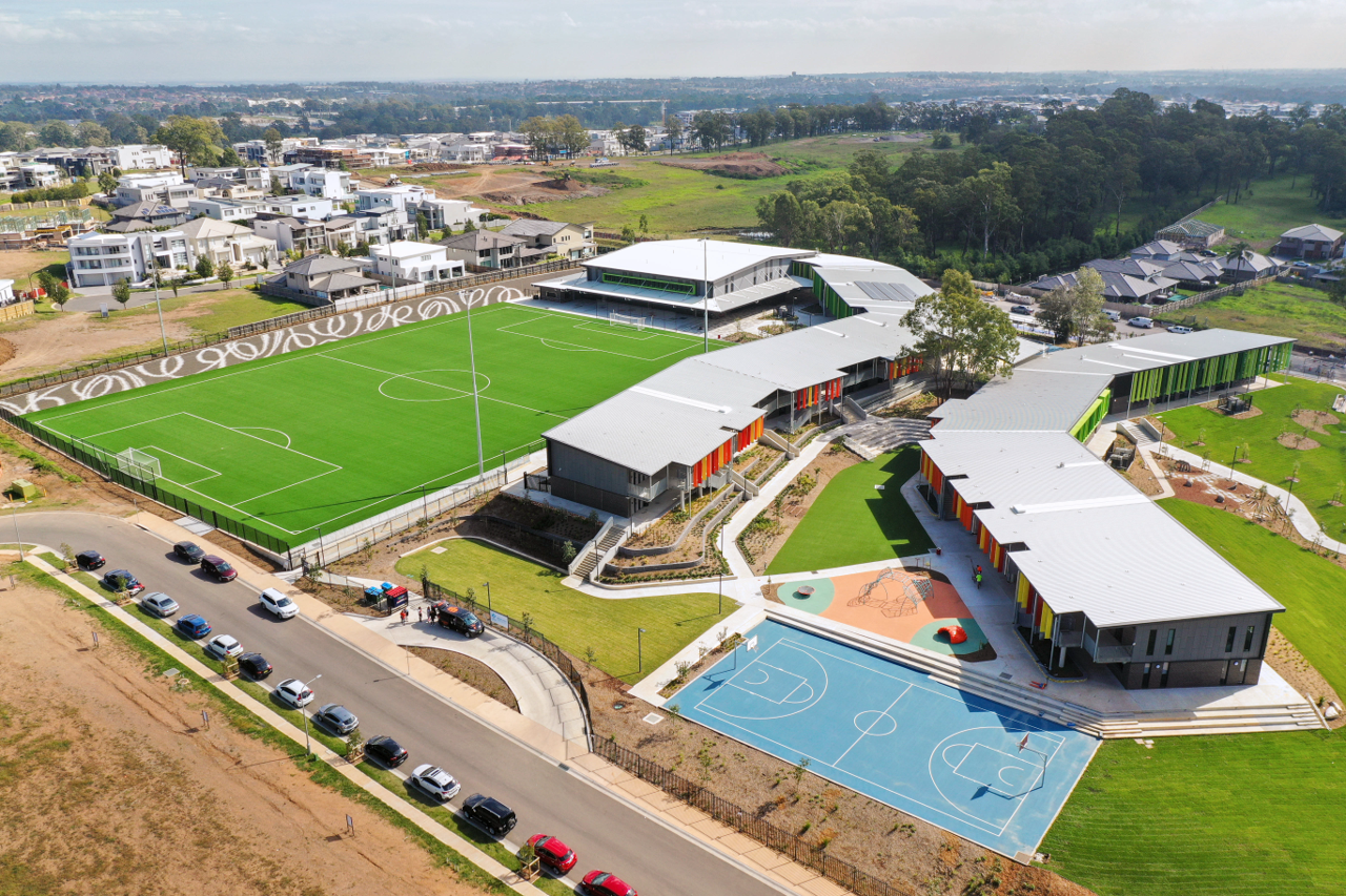 An aerial view of a school and playing fields