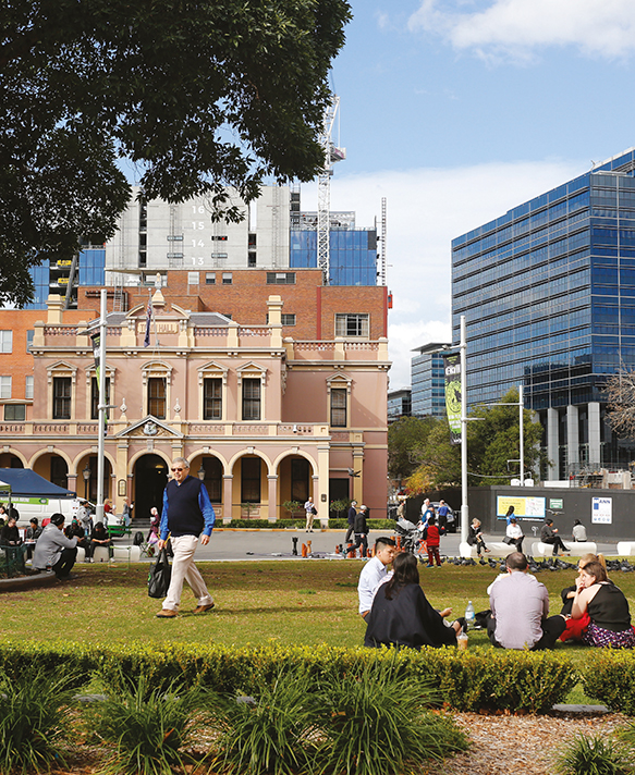 Photograph of group sitting in front of building in Parramatta CBD