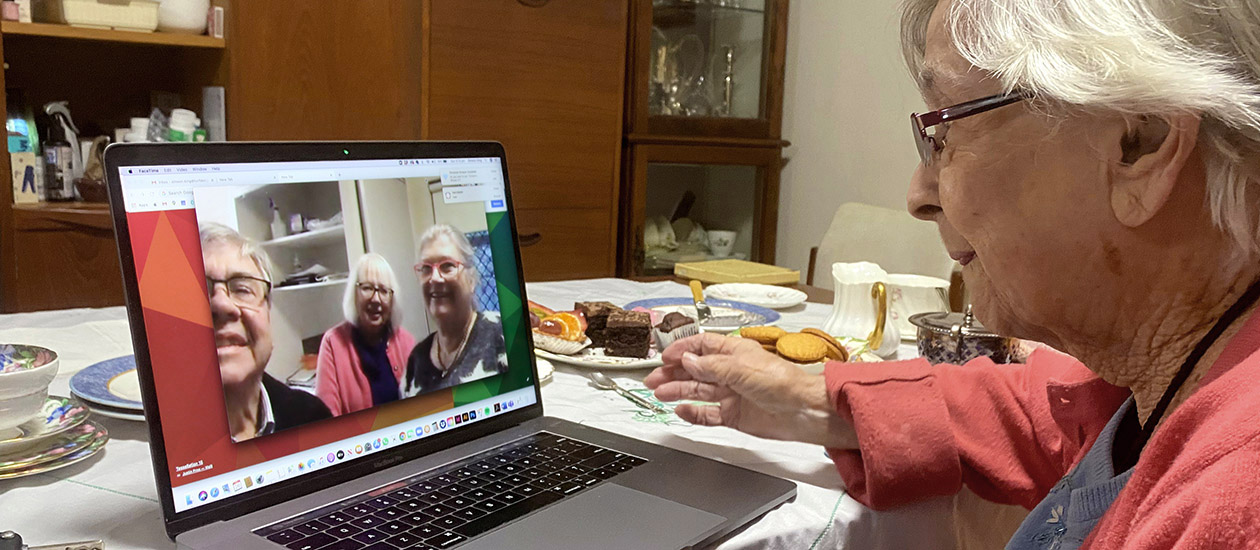 Lady using a laptop to have a virtual meeting