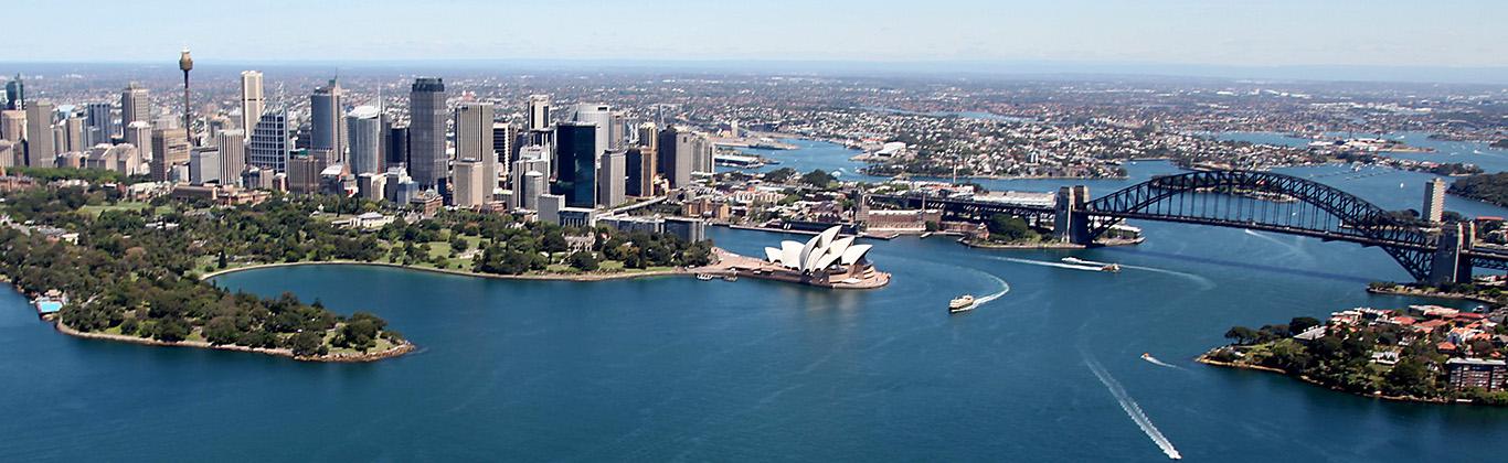 Aerial photo of Sydney Harbour looking across the Harbour Bridge and the CBD towards Parramatta.