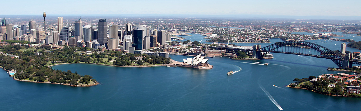 Aerial photo of Sydney Harbour looking across the Harbour Bridge and the CBD towards Parramatta.