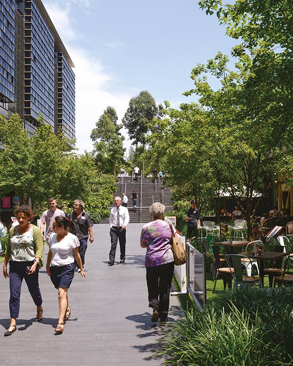 Photo of people in walkway between buildings