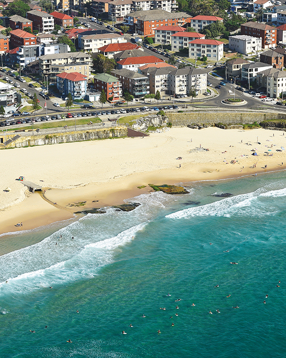 Aerial photo of Maroubra beach and adjacent apartment buildings.