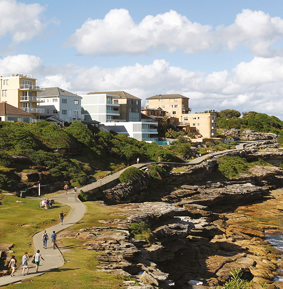 Photo of people using a walking path along the rocks above MacKenzies Bay.