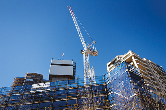 Photograph of a crane at a construction site in Bondi Junction.