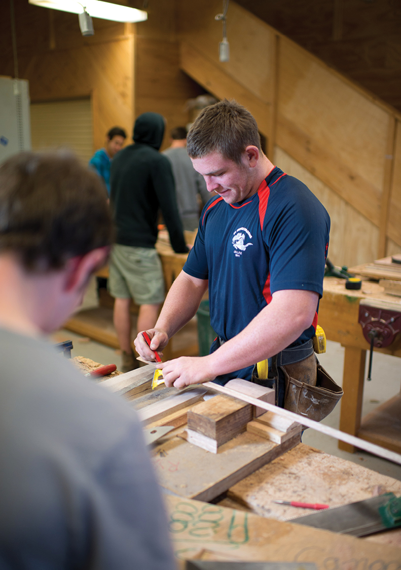 Photograph of a male Carpentry and Joinery student at Gymea TAFE.