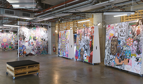 Photograph of an art installation in a converted industrial space.