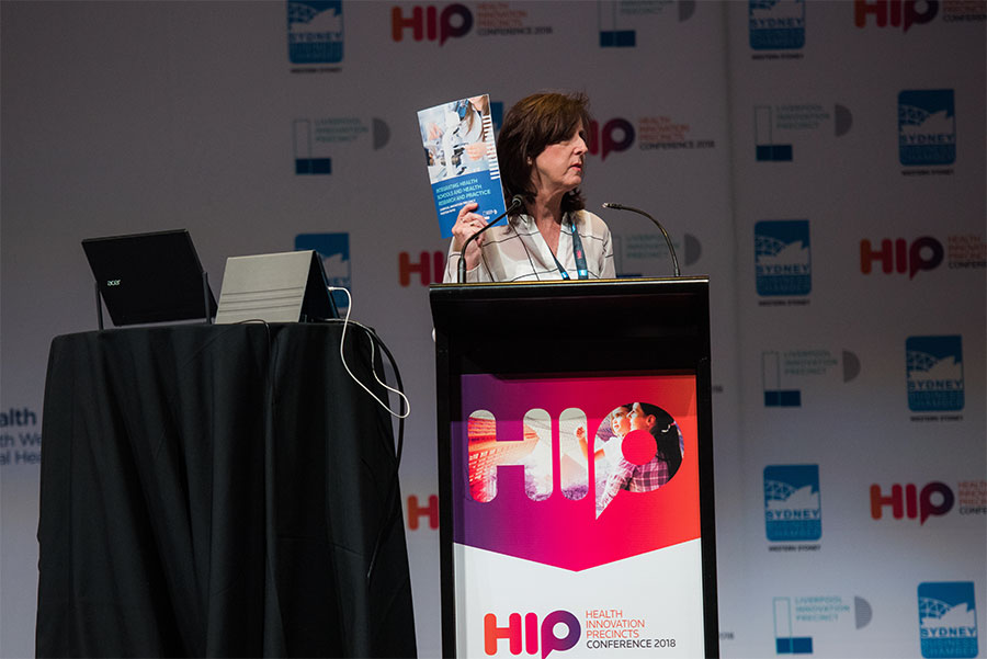 A woman presenting at a lectern