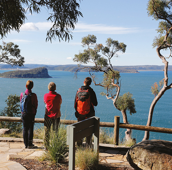 A photograph of people at West Head overlooking Broken Bay and Lion Island.