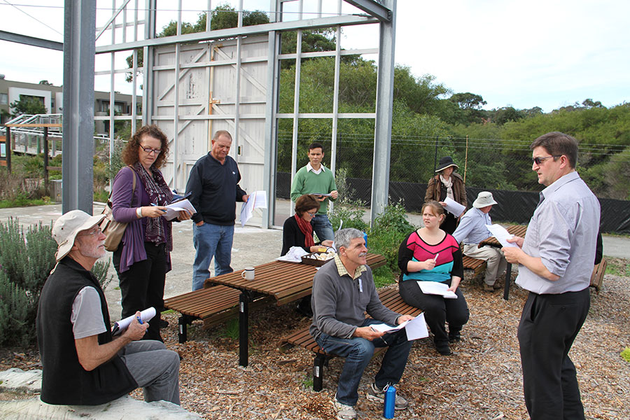 A community education workshop being held in a park