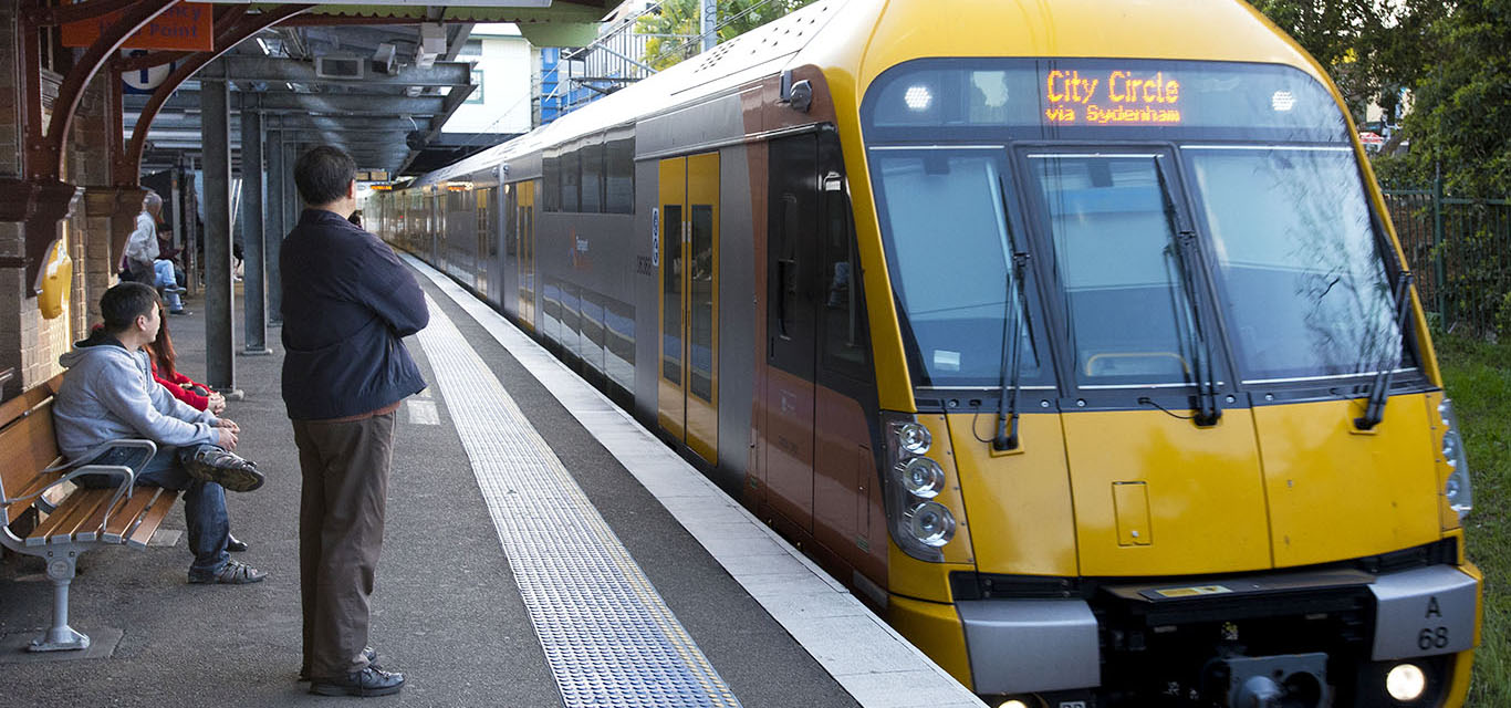 A photograph of a city bound train arriving at Bankstown railway station