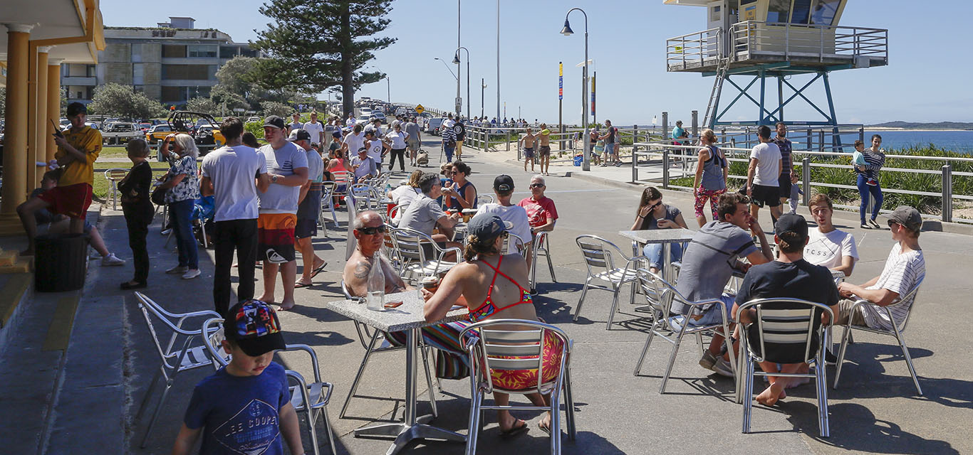 A photograph of people at outdoor cafe, The Esplanade, Cronulla Beach.