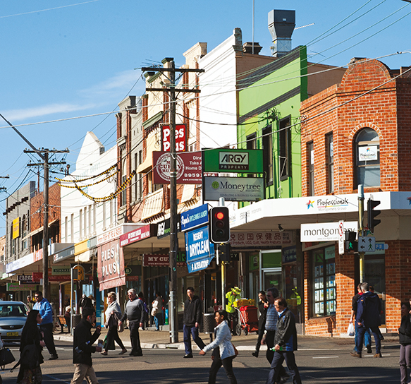 A photograph of people crossing the road at Kogarah town centre.