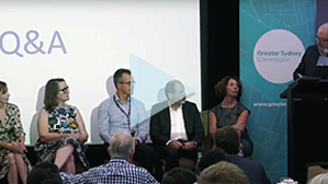 Presenters from the Greater Sydney Commission, Transport for NSW and Infrastructure NSW on stage during a Community Briefing.