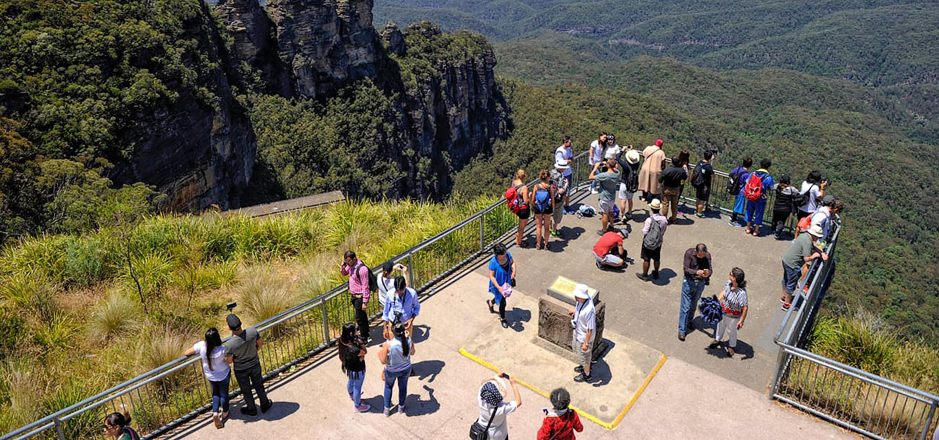 Photograph of visitors at a three sisters lookout in the Blue Mountains.