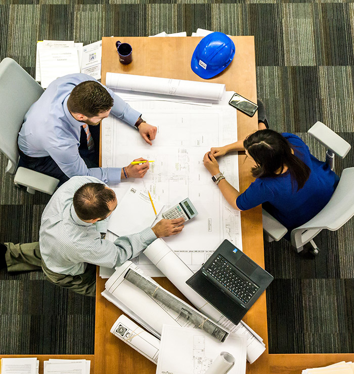 Three workers in a meeting