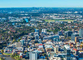 Aerial view of the Parramatta CBD with the Sydney CBD in the distance