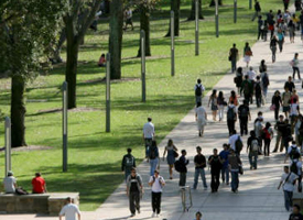 People walking through a city park
